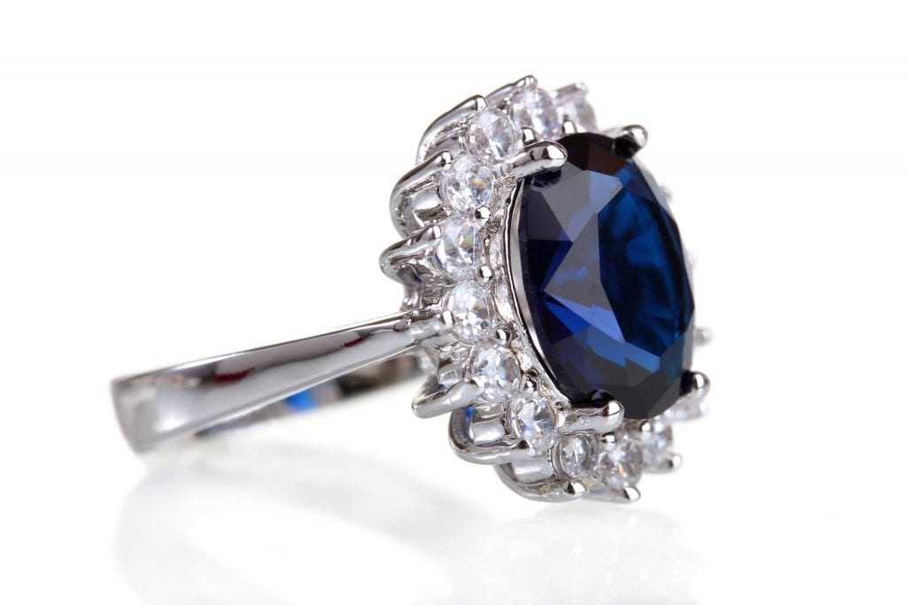beautiful ring with blue gem isolated on white